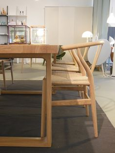 Essay table by Cecilie Manz from Fritz Hansen and Wishbone chair by Hans J Wegner from Carl Hansen
