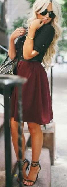 Black button up blouse with a cranberry colored skirt