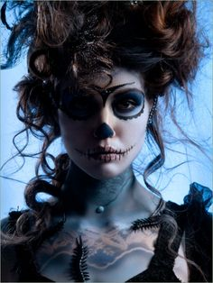 Nice sugar skull makeup, and a touch of bugs. For some reason I'm really digging the hair too!