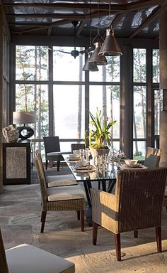 I love this screened in porch by BETH WEBB ~ INTERIOR DESIGN. I love the stone floor, the wicker furniture, the dash of elegance provided by the glass table and the sideboard. A truly gorgeous spot.....V