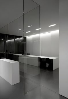 Another view of the Down-in-Line lighting by Kreon in a minimalist bathroom with an extra large bathtub_