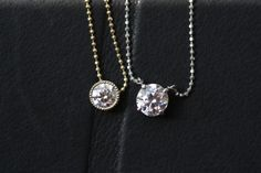 The yellow gold bezeled by BGD and is a .5 and the white gold is .91