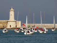 Sailboats leaving port for a race