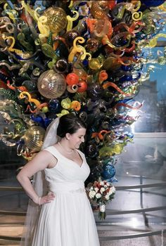 Saw this sculpture on a field trip to the art museum in middle school ten years later we were lucky enough to get married in front of it. Joslyn Art Museum Omaha Nebraska. (Inside&Out Chihuly 2000)