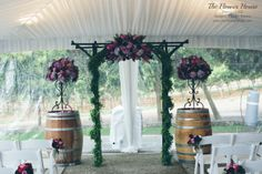 Altar arrangements with hydrangea and roses in lavender, plum, and magenta by www.theflowerhouse.com