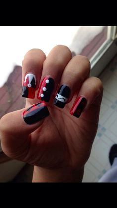 A wicked set of Harley Quinn nails. ;)