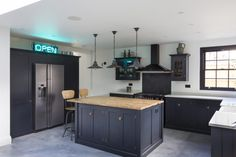 Barn Wood worktop adding warmth to this sophisticated shaker kitchen. Open Plan Kitchen Living Room, Barn Kitchen, New Kitchen, Kitchen Decor, Kitchen Cupboards, Modern Kitchen Renovation, Kitchen Remodel, Devol Shaker Kitchen, Kitchen Diner Extension