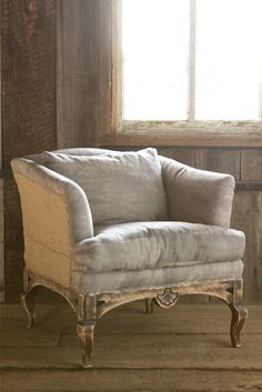 I love the style of this deconstructed club chair. Sanded wood, burlap sides and exposed upholstery tacks make for Shabby but not too Chic!