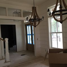 Love the wood paneling on the walls/ceiling, entry way light fixture and dinning…