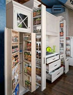 To maximize the use of space, think tall vertical pull out shelves.
