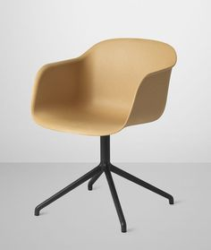 Muuto's Fiber Chair in nature composite with swivel base.