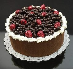 Display Fake Food's Wild Berry Topped Cake. A selection of our faux berries top this chocolate sponge cake make a beautiful display!