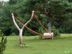 Cornelia Konrads see http://www.thisiscolossal.com/2012/04/gravity-defying-land-art-by-cornelia-konrads/