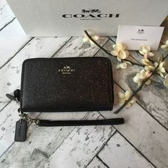 Coach Wallet/Wristlet NWT Brand new with tags Authentic Coach Wallet /wristlet in black glitter with silver zippers! Double zipper compartments, very spacious. Leash is detachable to allow a carry as a wristlet or for use as a wallet.     Includes gift box                        ‼️‼️ NO Trades‼️‼️             offers appreciated thru the offer button.              〽️ercari always has listing at a lower price ! Coach Bags Wallets