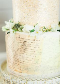 Creative Ways to Incorporate Prints and Patterns into Your Wedding Day. Ivory cake with green accent flowers.