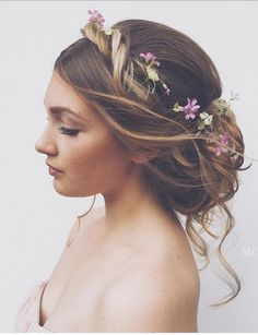 A feminine romantic updo. The style looks neat yet undone at the same time. It looks effortlessly beautiful you'll look like an angel sent from above.