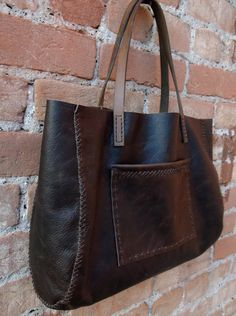 Cibado Leather Bags - Hand sewn dark brown leather tote with cross stitched gussets, old horse tack handles and 1 exterior patch pocket. Unlined.