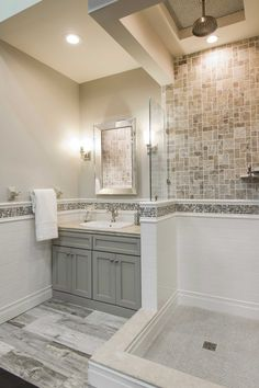 Warm bathroom wall tile - Claros Silver Remzi travertine tile https://www.tileshop.com/product/657555-P.do
