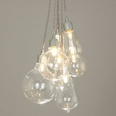 Dangling from a single main cord, this light combines seven assorted sizes of light bulb.