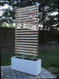 Mobile Vine Wall - Concept- This concept consists of a mobile planter base made from a solid piece of cast concrete. The bottom of the base is inset to accommodate four 360 deg. The vertical wood structure forms a con… Garden Arbor, Garden Fencing, Balcony Garden, Building A Pergola, Pergola Plans, Beautiful Home Gardens, Vine Wall, Pergola Designs, Trellis