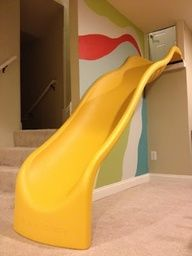 A slide into the basement playroom... yes please!