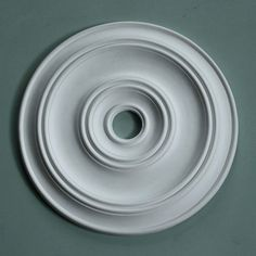 This clean and simple medium sized ceiling rose has a pleasing symmetry that is easy on the eye with a tactile quality that you only get with plaster.