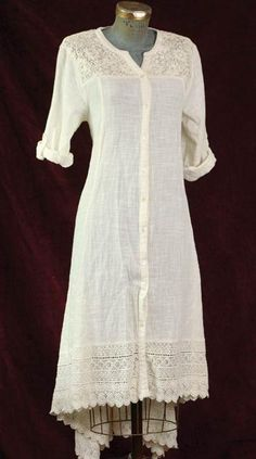 April Cornell Casablanca Shirtdress  Lace yoke. Bias-cut hem extended in back. Mother-of-pearl button waist and sleeve tabs.  Victorian Trading Co