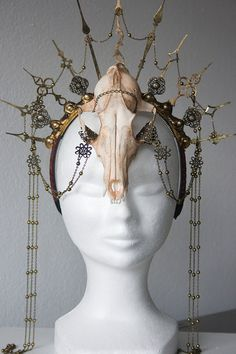 Brass clock hands mounted on a headband, a fox skull as centerpiece finished with intricate chains, you will definitely get some attention when you don