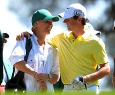 Rory McIlroy and Caroline Wozniacki at the Par 3 contest at the 2013 Masters.