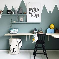 Floating desk and mountain mural