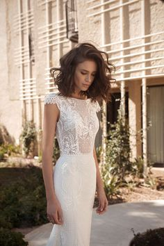 Julia from Flora wedding dresses 2018 - Boat neck line with capped sleeves. Sheer bodice with a lace overlay. Embroidered detailing with pearls and crystals. Fitted skirt, boned bodice.- see the rest of the collection on www.onefabday.com