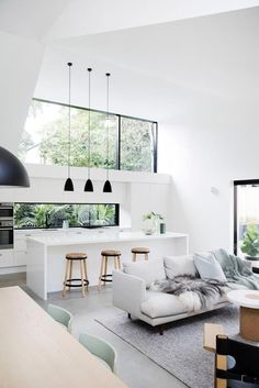 Dream house interior | white open plan kitchen | high ceilings and large windows