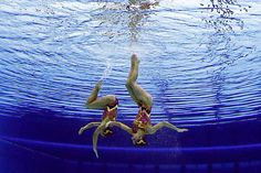 Sara Labrousse and Chloe Willhelm of France compete during the women's duet synchronized swimming technical routine at the Aquatics Centre in the Olympic Park during the 2012 Summer Olympics in London, Sunday, Aug. 5, 2012.