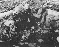 American soldiers find a dead body near ground zero after the bombing of Nagasaki. All that remains is a handful of ashes and part of a skeleton.