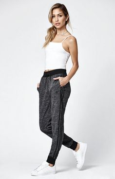 """Slip into all-day comfort in this relaxed look by adidas. Heathered fabric, cuffed ankles, side zip pockets, and iconic 3-Stripes along the sides lend fashion and form to the Regular Cuffed Track Pants. Match them with a hoodie or basic tee for sporty-chic style.   29'' inseam (size Med) Ribbed, elasticized waistband Concealed side zip pockets Ribbed cuffs Small embroidered logo at the hip Model is wearing a small Model's measurements: Height: 5'7"""" Bust: 32'' Waist: 2..."""