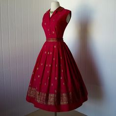 "Gorgeous red 50s dress.   I will incorporate this colour in my next round of redecorating...   I love the lush visual ""feel"" of opulence that this colour alludes to."