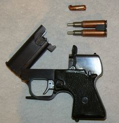MSP pistol, opened after firing. Note the clip with two fired SP-3 shells and recovered 7.62mm M43 bullet