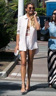 Chrissy Teigen leaving the Grand Hyatt Cannes Martinez Hotel in Cannes, France on June 24, 2015, wearing a La Perla Nervures Satin-Trimmed Stretch-Tulle Bodysuit and  Giuseppe Zanotti Mirrored Leather Triple Strap Hi Sandals. #chrissyteigen #style