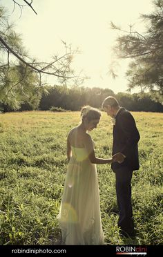 bride and groom, country wedding, wedding photojournalism, visual storytelling, just married, country field, sun flare, pine trees