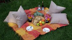 date idea #3: plush picnic.  Most of these dates assume food is involved somewhere but a plush picnic outside (I would take it a step further and do it in the evening by candlelight...with bug spray) could be very romantic (and CHEAP!).  I like the idea of a throw pillow for each person to relax on.  Bonus points if you can wrangle a friend into setting it up for you so the two of you arrive together and it's already set to go.