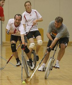 Unicycle hockey. This seems crazy...but I used to play this at the unicycle conventions.