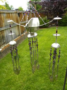 Wind chime art with assorted whimsical silver pieces - funky garden art - assorted colors of purple glass beads - spoons, forks, gravy boat