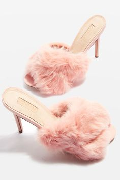 Totally elevate your party look in these mule sandals in pink featuring luxe fur detail to the straps, with a mid-to-high heel.