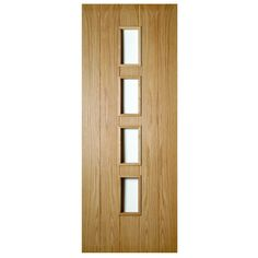 An unfinished internal oak FD30 fire door with five vertical boarded panels and four unglazed lights. The Galway oak door is a modern door with a wonderful contemporary oak finish, also available as a standard door. | J003696C