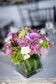 purple green white flower arrangement: love the vase and the bouquet shape, would do in just green and white
