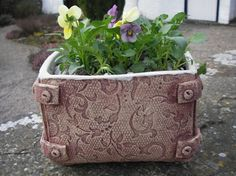 Textured handbuilt slab planter, with glaze on the inside only.