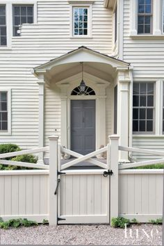 white classic, like the portico and half pie shaped transom window above the front door.
