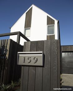 Smart and welcoming The exterior cladding of the house includes vertical weatherboards finished in Resene Waterborne Woodsman CoolColour tinted to Resene Pitch Black, as is the fence.