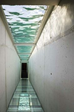Reflections of pool above GLASS FLOOR. Also concrete walls.