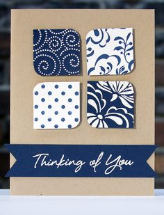 handmade card ... clean and simple design ... four square of die cut rounded squares and a fishtail banner with the sentiment ... like the look of deep blue and white on kraft ... graphic appearance ... Hero Arts ...
